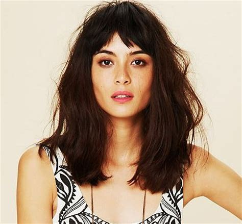 short haircut with full bangs long top tapered back brow length fringe tapered to lash length at sides with