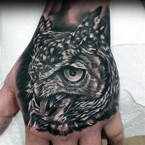 owl hand tattoo 40 unique tattoos for manly ink design ideas
