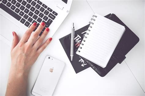 hands free desk phone white laptop female hand note pen phone desk 183 free