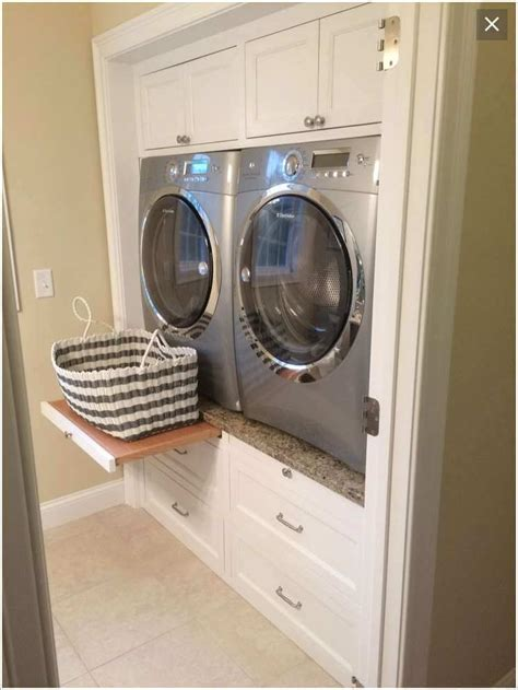 How To Build Laundry Room Cabinets Build A Space For The Washer And Dryer Between Cabinets And Drawers Designs