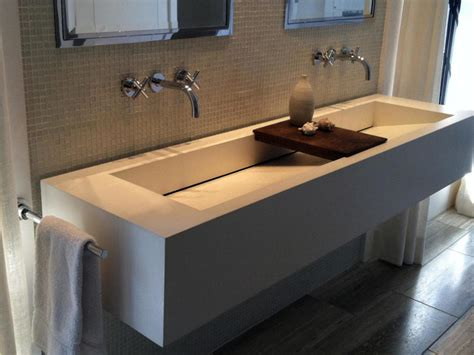 white floating bathroom vanity white cement floating bath vanity trough sink and iron faucet on gray tiled backsplash