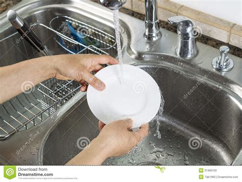 Hands Free Kitchen Faucet by Woman Hands Washing Dinner Plate In Kitchen Sink Stock