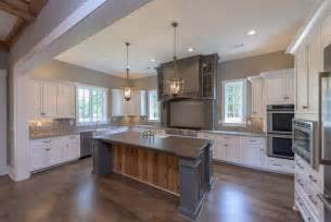 traditional kitchen with rustic wood island white cabinets dark barstools contemporary