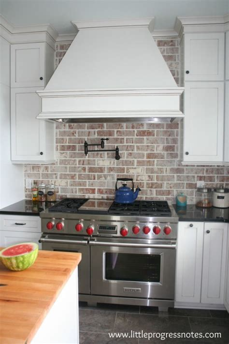 white brick backsplash brown granite countertops blue brick tiled