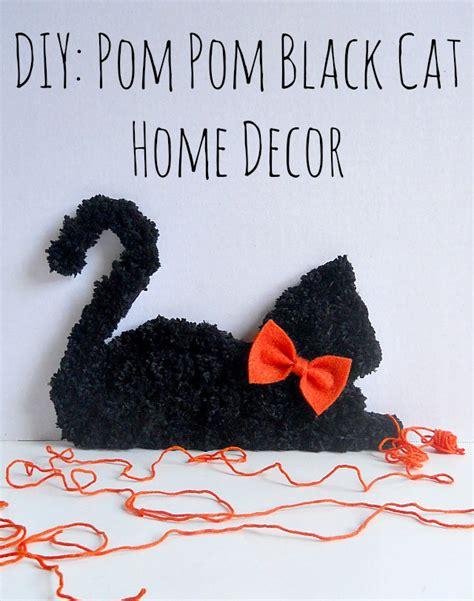 pomeranian with cats running with a glue gun diy pom pom black cat home decor