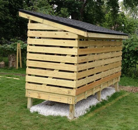 building firewood rack with roof simple diy covered firewood shed storage with roof in the small backyard spaces with green grass