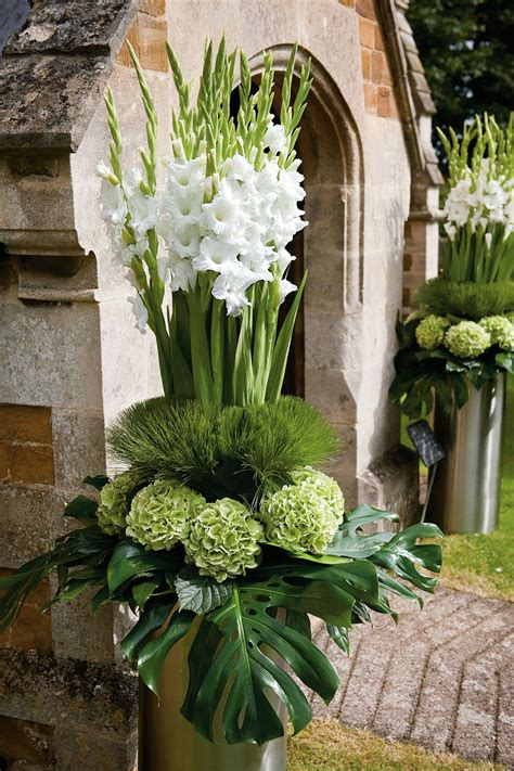 how to make tall flower arrangement in urn youtube modern white wedding pictures bridesmagazine co uk