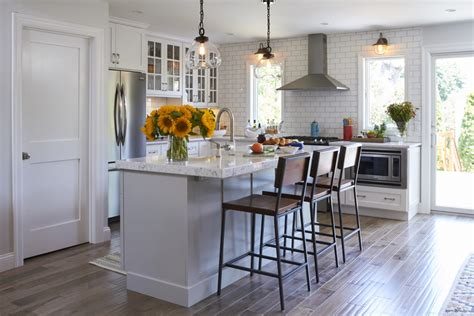 simply white kitchen  light grey island crystal cabinets