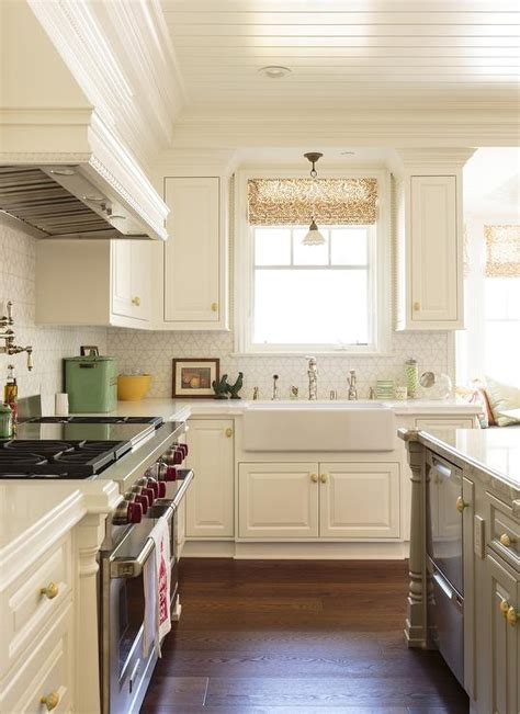 white cabinets with gold hardware white kitchen with gray island fitted with gold hardware