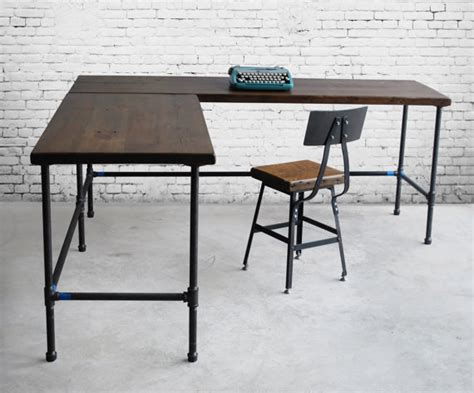 custom desk made of reclaimed wood and iron pipe legs