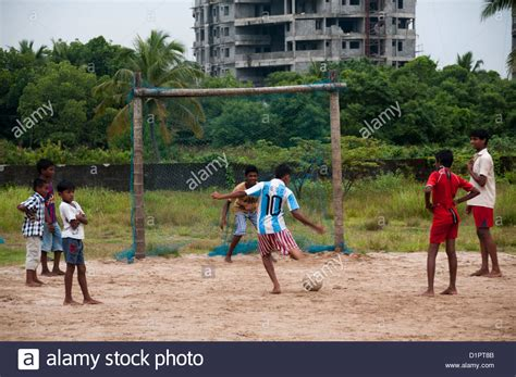 swinging india children playing football in rural village cochin india