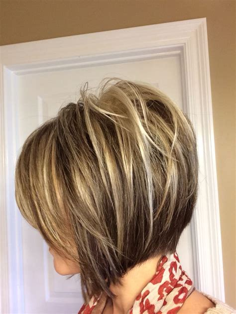 very short hairstyle with highlights lift and a bump on inverted bob short hairstyle with highlights thinking