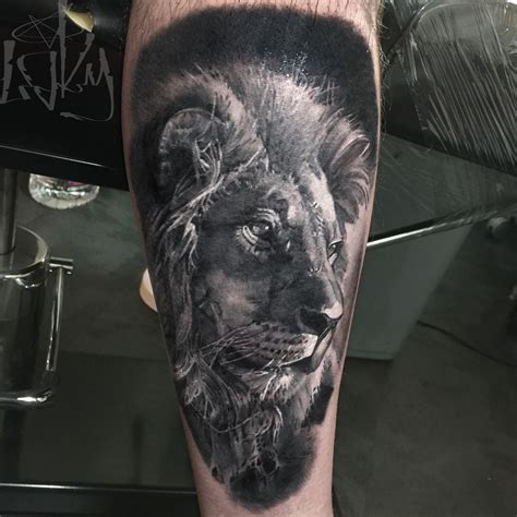 realistic lion head tattoo on arm by maksims zotovs