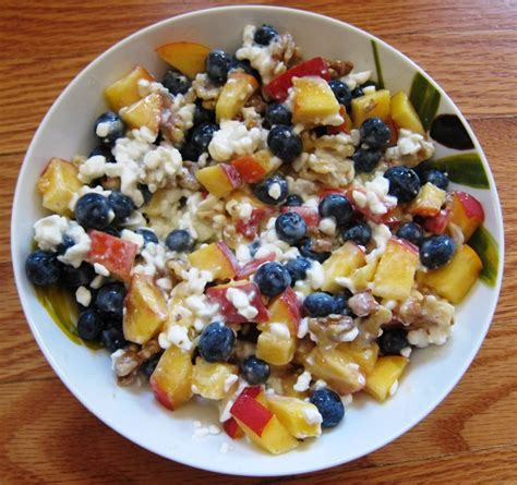 cottage cheese with blueberries peach and walnuts