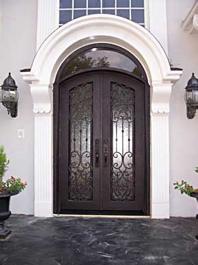 love the double front doors and tall windows maestri love these double front doors and the arch home decoras