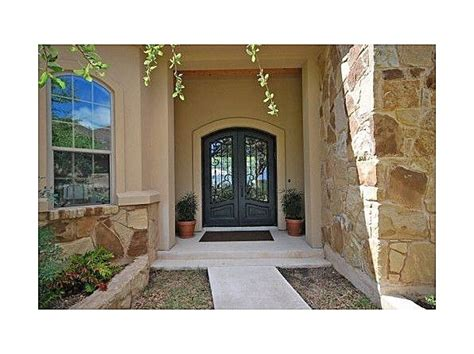 Mediterranean Style Front Doors Front Door With Iron Fencing Mediterranean Style Home Is Surrounded With Oak Trees And Forever