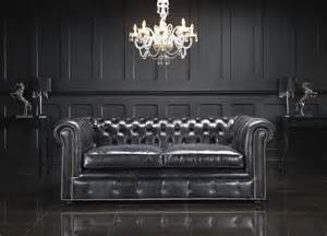 Chesterfield Black Sofa Living Room With Black Leather Chesterfield Sectional Sofa And Black Wooden Wall Panel Also