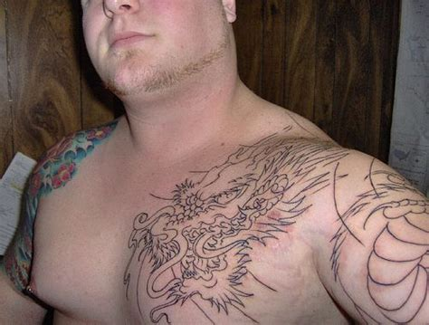 axis tattoo after session on left half sleeve and chest cap