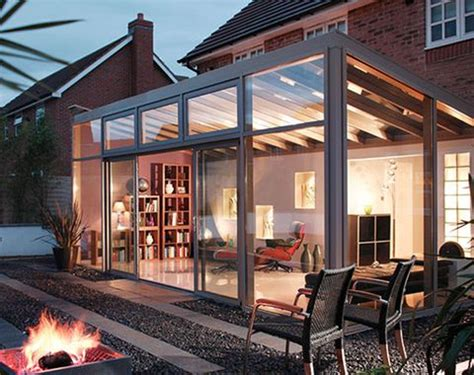 modern conservatory sloping up roof with beam along back to allow window