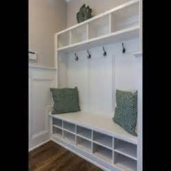 Entryway Bench With Coat Hooks The Gates At Ethan S Glen Gold Parade Home By Robuck