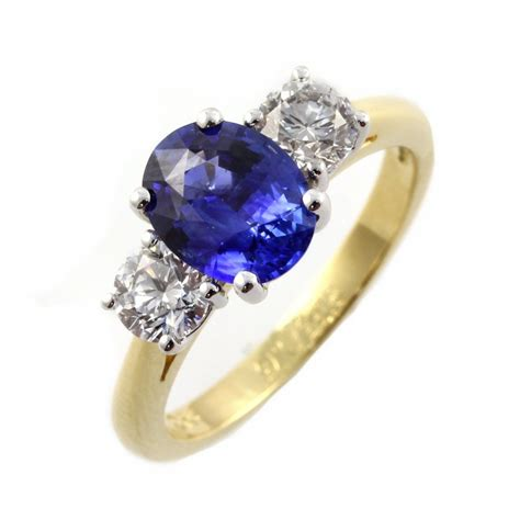 18ct yellow gold oval sapphire amp diamond 3 stone ring