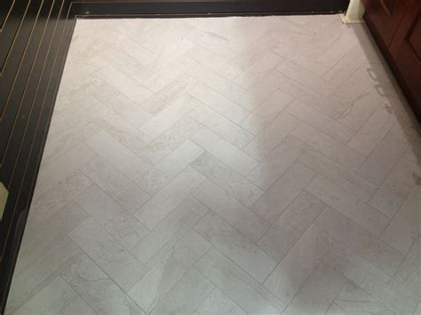 6 x 24 tile Leonia Silver floor herringbone pattern