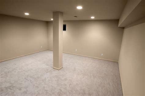 painting concrete basement floor with white color plus wall and ceiling with light brown