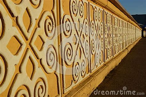 stone banister sunlit yellow stone banister with white pattern stock