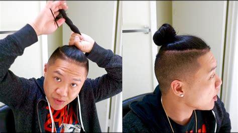 tie man bun  longer hair   wear hat  long