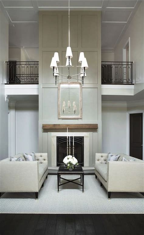 stunning  story living room board  batten fireplace