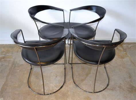 black leather and metal dining chair four black leather and gun metal chrome dining chairs by