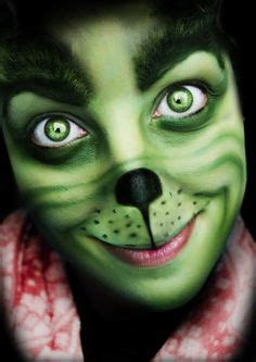 step  step process    achieved  grinch makeup  cover  face  green paint
