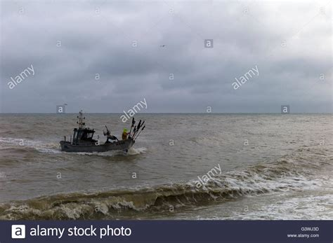 small fishing boat in rough seas small fishing boat coming into land in rough seas