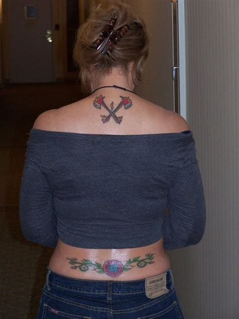 firefighter tattoo on upper back of woman tattoos book