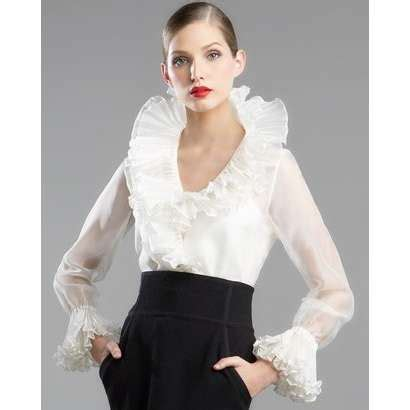 Couture and elegant style this blouse is high fashion in every way