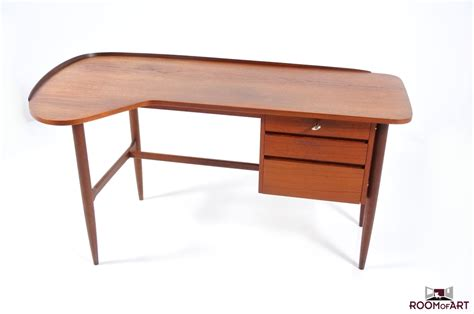 mid century kidney desk in teak room of