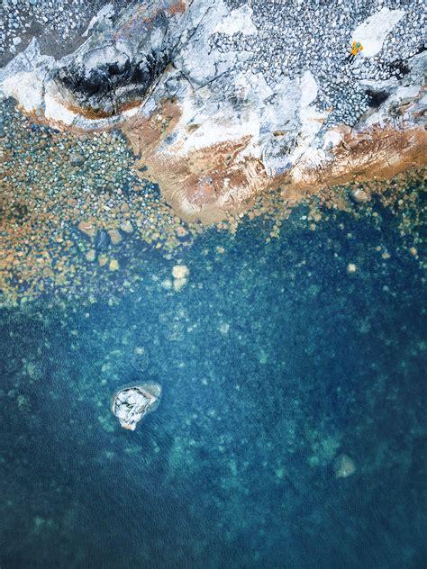 wallpaper rocks stones beach clear water hd