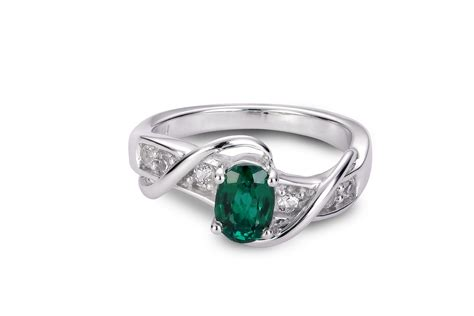 oval created emerald and sapphire ring charm centres