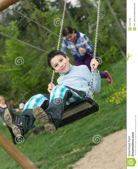 baby boy swing baby boy playing on swing royalty free stock photos