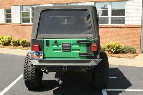 jeep rear bumper jeep tj lj rear bumper tire carrier fab fours