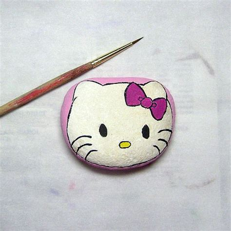 themes rock kitty hello kitty painted on a rock painted rocks cats