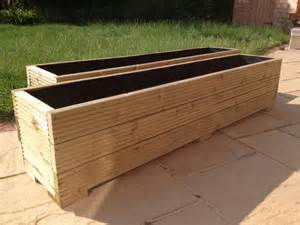 Large Patio Planter by Large Wooden Garden Planter Trough In Decking Boards