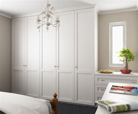 wardrobes along left wall dressing table drawers