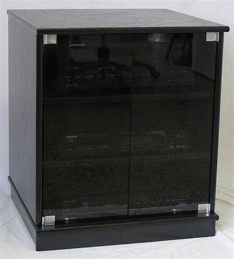 small black cabinet with doors of small black oak tv stand with gray tint glass doors