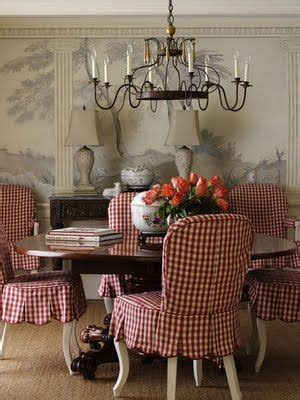 gingham armchair dining room red checks gingham slipcovers chandelier