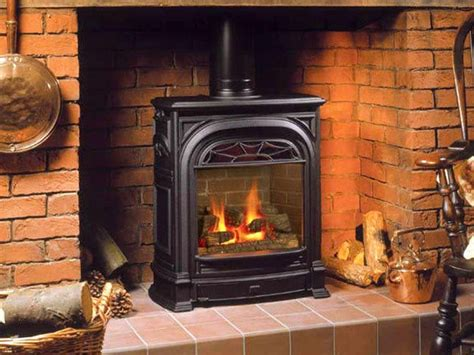 Buck wood stove on Custom Fireplace. Quality electric, gas