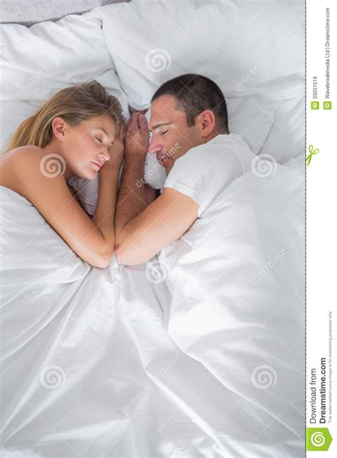cute couples in bed cute couple lying asleep in bed overhead shot royalty free