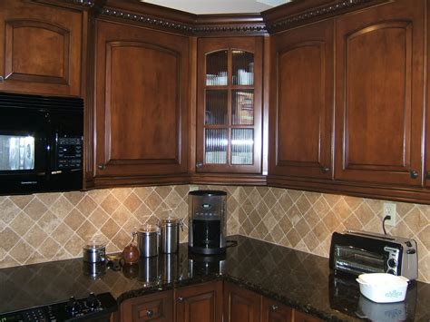 kitchen backsplash with oak cabinets and black appliances light colored oak cabinets with granite countertop here