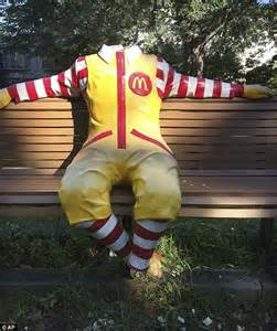 ronald mcdonald bench statue of ronald mcdonald on a bench outside a care home
