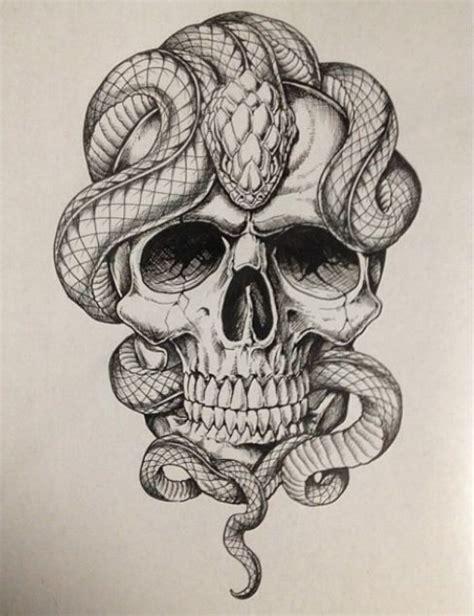 black and white snake tattoos black and white snake lying on skull design